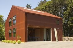 """Aptos Retreat by CCS Architecture NY [Garage door open leads to a lovely indoor/outdoor """"thing""""! So nice!]"""