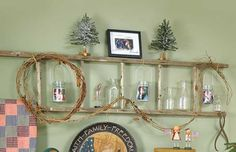 Hang photograph-filled jars on a wood ladder hung horizontally. Attach a length of grapevine for natural texture. Find more great decorating secrets in every issue of Country Sampler. Order your subscription here: https://ssl.drgnetwork.com/ecom/csl/app/live/subscriptions?org=csl&publ=CS&key_code=EYJCS02&source=pinterest