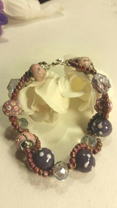 Purple and lilac glass bead bracelet by SnoBirdBeads on Etsy