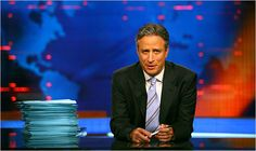 """Jon Stewart. While he possesses Johnny Carson's talent for listening and George Carlin's gift for observation, his comedy remains rooted in his informed reactions to what Tom Wolfe once called """"the irresistibly lurid carnival of American life,"""" the weird happenings in """"this wild, bizarre, unpredictable, hog-stomping Baroque"""" country."""