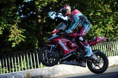 IOM TT 2010. Connor Cummins riding Macadoo Kawasaki. Macadoo are deeply religious team and believe racing shouldn't happen on the sabbath. This had led to fallings out with organizers and riders alike. Arguably not as mush as their striking livery!