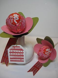 Valentine Treats; tootsie pop, construction paper and hold it on with a small rubber band.