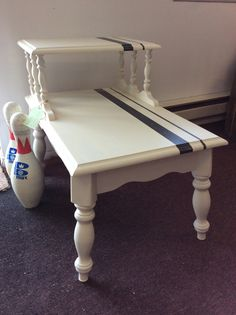 """End table white with black stripe dimensions-18""""w 27""""d 23"""" tall"""