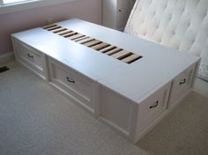 has about 8 posts on the making of this bed.  6 drawers, twin size