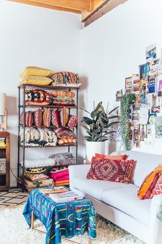 Comfy sofa and cushions in a happy and relaxed, boho studio in L.A