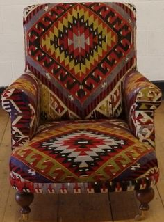 high backed armchair upholstered in vintage anatolian kilim