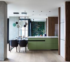 Modern kitchen/dining room in a combination of green and blue with hanging lamps Apartment Interior, Apartment Design, Kitchen Interior, New Kitchen, Kitchen Dining, Kitchen Decor, Dining Room, Dining Table, Cocinas Kitchen