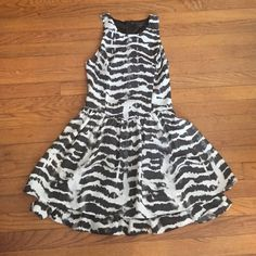 Black and white party dress This party dress is so cute, comfortable, and easy to go from event to club. Razor back and high neck fits the body tight until the hips where it flares out. Guess Dresses Mini
