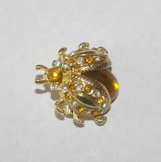 Hey, I found this really awesome Etsy listing at https://www.etsy.com/listing/104469893/vintage-lady-bug-brooch-yellow-and-clear