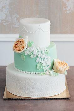Vintage wedding cake - mint, apricot peonies, white hydrangeas, lace