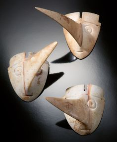 Mississippian culture. Lightning whelk Long-nosed god maskettes, ca. 1150-1450, probably represent a deity or deities. They have been found in eastern Florida, eastern Oklahoma, and several sites on the upper and middle Mississippi River, depicted on engraved shell cups, redstone sculptures, and in pictographic form at Picture Cave in Missouri.