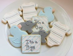 Baby shower cookie favors decorated for a boy in blue and gray: onesies, ducks, elephants and personalized squares, 1 dozen. $40.50, via Etsy.