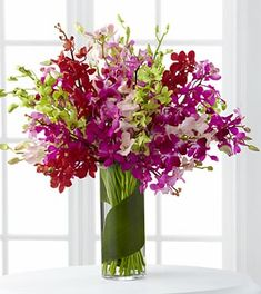 I like the green accent: Luminous Luxury Orchid Bouquet - 30 Stems - VASE INCLUDED- Shown