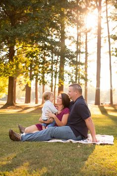 Look at this beautiful family session outside! The park was a perfect place for pictures and this baby boy just turned one!