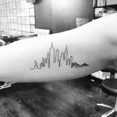 New York skyline tattoo on the right inner arm. Tattoo artist: Jon Boy · Jonathan Valena
