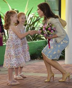 Denmark's Crown Princess Mary Receives flowers from identical twins Lillian, left, and Charlotte Harding