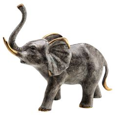 Brass elephant statuette.  Product: StatuetteConstruction Material: BrassColor: Distressed brass...