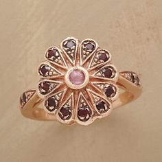 VINTAGE ROSE RING -- Arik Kastan recaptures vintage romance in his 14kt rose gold ring, intricately worked and set with a pink tourmaline ringed by garnets. Handcrafted. Whole sizes 5 to 9.