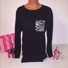 NEW XS PINK VS LONG SLEEVE SHIRT PINK VICTORIA'S SECRET LONG SLEEVE SHIRT  LONG SLEEVE SHIRT WITH ZEBRA PATTERN ON THE POCKET.  COLOR WHITE/BLACK  SIZE XS (OVERSIZED)   FAST SHIPPING!!!      Check out my other items! I am sure you will find something that you will love it! Thank you for watch!!!!!   Be sure to add me to your favorites list! PINK Victoria's Secret Tops Tees - Long Sleeve