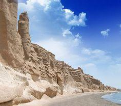 Lonesome volcano-sculpted Baxedes Beach on Santorini