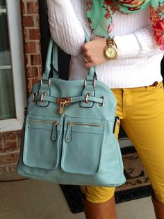 mustard skinny jeans, turquoise purse, white sweater, brown boots, floral printed scarf