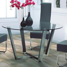 The round glass table; the grey seating; the wooden floors; the white walls. Everything about this is me.