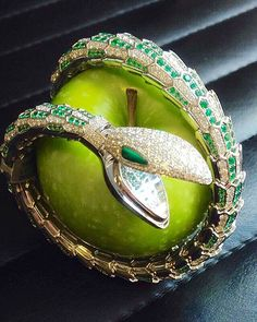 Ready to bite!  An emerald and diamond 'serpenti' watch bangle, by @bulgariofficial Lot 202, London Important Jewels sale, 15th June. #christiesjewels #christiesinc #snake #serpenti #watch #bangle #emerald #diamond #white #gold #bulgari #powerful