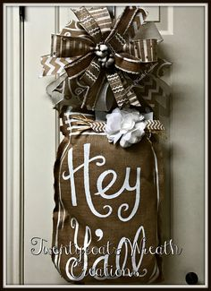 """Burlap """"Hey Y'all"""" door hanger with bow and cotton bolls by Twentycoats Wreath Creations (2017)"""