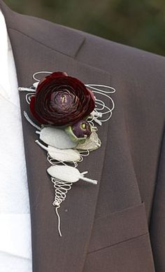 The Ranunculi are really stunning in this boutonniere.
