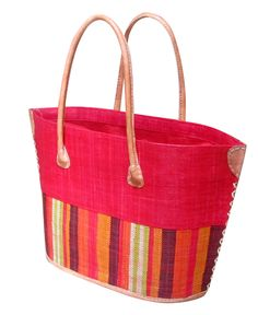 Smaller version of beach basket in red with drawstring closing and leather handles and reinforcements.
