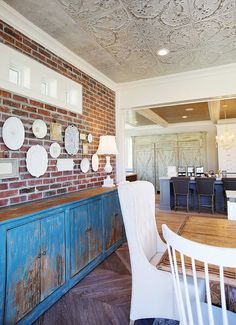 brick wall- patterned ceiling- herringbone floors House of Turquoise: Dream Home Tour - Day Two
