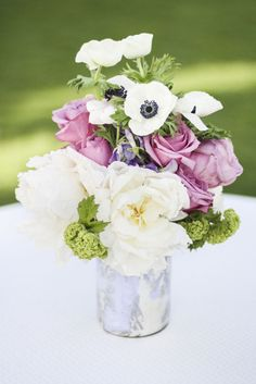 Anemones and purple roses. Photography by jaycwinter.com  Read more - http://www.stylemepretty.com/2013/09/10/kauai-wedding-from-photography-by-jay-c-winter/