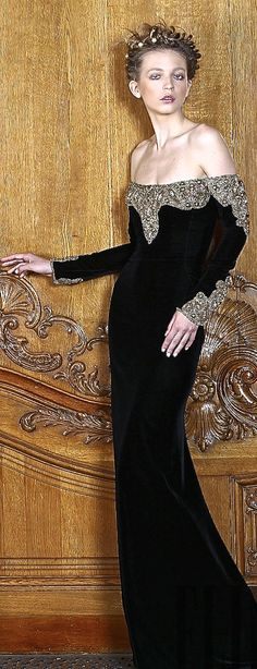 Dilek Hanif. she looks dead and because she is dead the dress is slowly slip down her corpes.