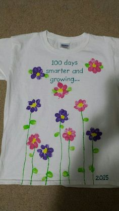 100th day of school shirt made with 100 thumb prints and fabric paint.