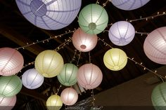 Wedding lighting at Ufton Court by Oakwood Events. Including fairy lights, festoon lights, paper lanterns, uplighting and more. Ceiling Decor, Ceiling Lights, Pastel Paper, Paper Lanterns, Lampshades, Fairy Lights, Barn, Table Lamp, Japanese