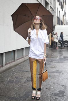 Colorblocked Cool: The coordination between her striped trousers and cutout shoes was perfection.