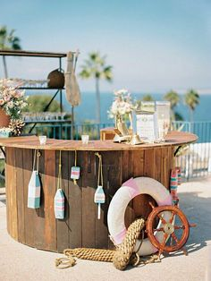 Keep the nautical theme up at the wedding bar with life savers, shells, and ship wheel Nautical Wedding Inspiration, Backyard Beach, Nautical Party, Nautical Wedding Theme, Vintage Nautical, Beach Bars, Coastal Decor, Coastal Cottage, Coastal Homes