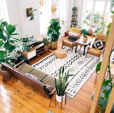 This mudcloth-inspired carpet makes a beautiful statement in this bright, bohemian living room.  Originated in Mali, mudcloth is traditionally printed on heavy cloth with mineral-rich clay. rp:@dachainteriors  #54kibo #contemporaryafricandesign #seeingafricadifferently #africaninspired #homedecor #interiorinspo #moderndecor #contemporarydesign #mudcloth