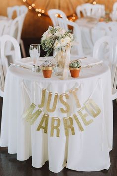 Just Married sign for the sweetheart table, photo by With Love & Embers http://ruffledblog.com/ostertag-vistas-wedding #weddingideas #signs