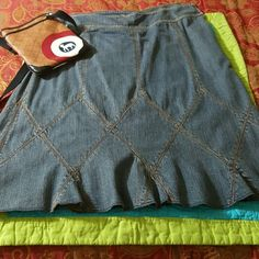 DKNY denim skirt Really cute skirt with side zip. The stitching at the bottom forms diamond shaped patterns all around the skirt. Falls below the knees. DKNY Skirts