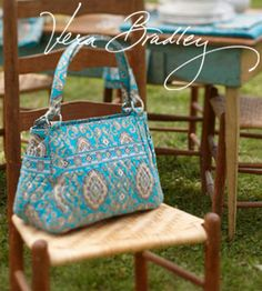 vera bradley - this one makes me HAPPY!!!  I sure hope someday I can get one!!