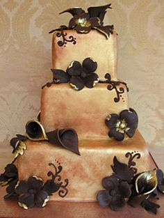 "Harvest Time    This richly colored cake is made-to-order for an autumnal celebration. Edible gold and rustic food coloring was painted over white fondant to create the ""faux gold"" color, while handmade chocolate flowers add a touch of natural beauty. Sedona Cake Couture, sedonacakes.com."