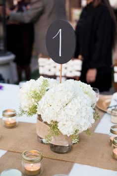 chalkboard table number signs and white hydrangea centerpieces