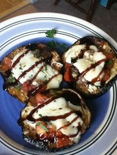 """Eggplant bruschetta. layer 1- Sliced eggplant layer 2- chopped roma tomatoes, crushed garlic, basil, and olive oil tossed in a bowl layer 3- mozz cheese, parm cheese, feta cheese topped with """"Blaze"""" balsamic glaze… any balsamic vinegar will do, or none at all.. it's mainly for the pretty look."""