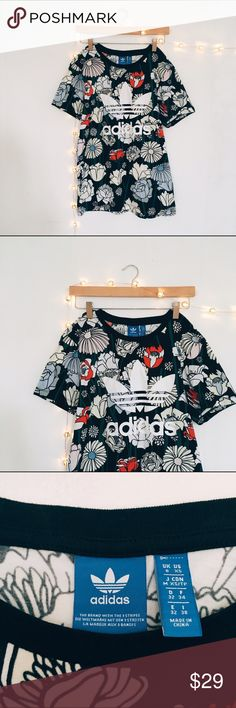 NWOT Adidas Floral Boyfriend T-shirt Damn adorable Adidas floral bf t-shirt with the cutest print. Never been worn out, only tried on. I'm obsessed with this floral print but sports wear doesn't fit my style so the only reason I'm selling this is because it was 100% an impulse buy 🙈 Boyfriend fit so it's an XS but fits like a S/M. Adidas Tops Tees - Short Sleeve