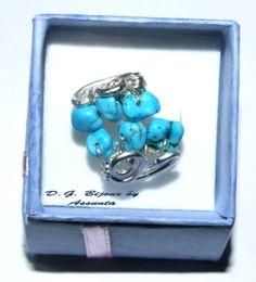 anello in metallo placcato argento e turchesi
