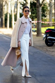 The Best Street Style At Paris Fashion Week Autumn Winter 2017, modest light pink ruffle top, pink coat and white pants.