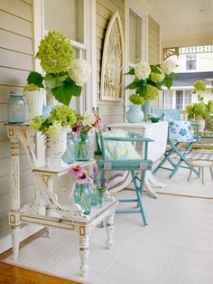Create a Theme  Bright colors and a weathered patina welcome visitors to this cheery porch. Flea market finds such as an old stepladder, a detailed mirror, and a pair of directors' chairs give the space an eclectic vibe. To ensure collected accessories look unified, choose a consistent color palette and stick to it throughout the entire space.