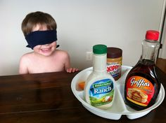 what's that smell? pick a few items from the fridge/cupboard, blindfolded have him guess the smell:)
