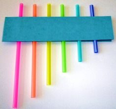 Homemade pan pipe - straws, glue, and cardboard.  Blow across the top of the straws to create sound.  Great way to illustrate that the longer the straw, the lower the sound.